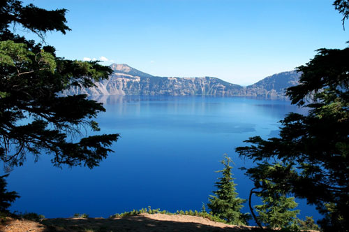 crater lake behind the trees by Flavia_FF, on Flickr